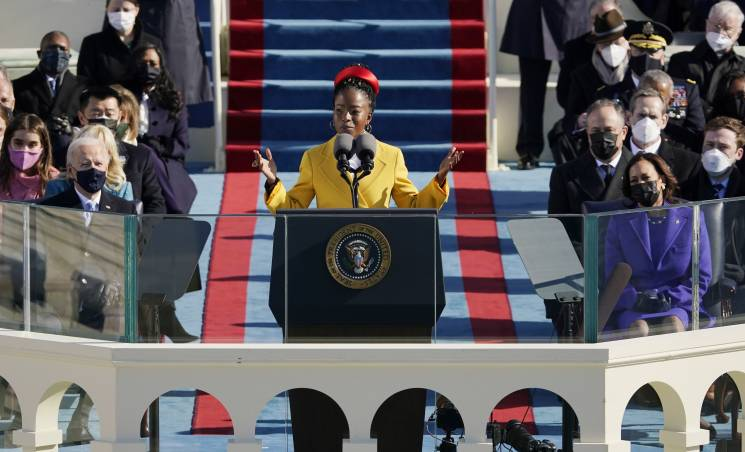 American poet Amanda Gorman reads a poem during the 59th inaugural ceremony on the West Front of the U.S. Capitol on January 20, 2021 in Washington, DC. During today's inauguration ceremony Joe Biden becomes the 46th president of the United States.; Getty