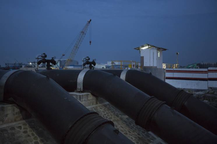 iant pipes used for pumping flood waters up into the sea from parts of the city below sea level on April 26, 2017 in Jakarta, Indonesia. Jakarta, one of the world's most densely populated cities, is also one of the fastest-sinking cities in the world under the weight of out-of-control development and rising sea levels caused by global warming.; Getty