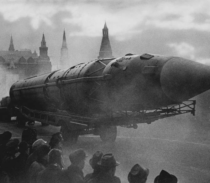 A missile is paraded down a street past the the kremlin.