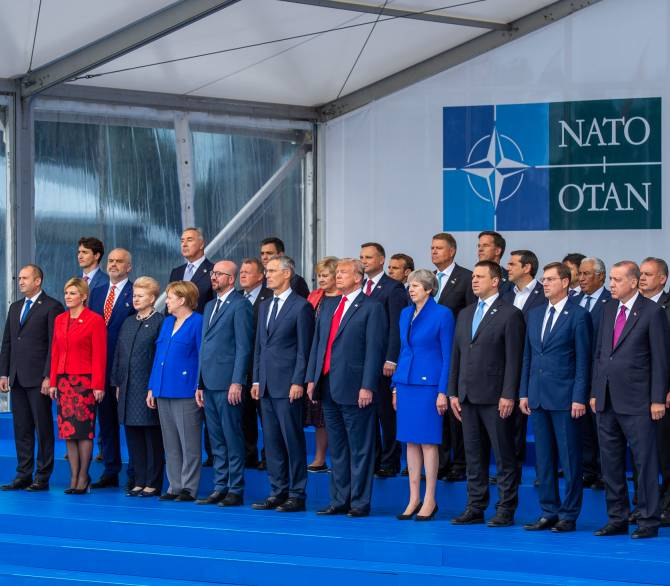NATO Heads of State and Government stand for an official portrait.