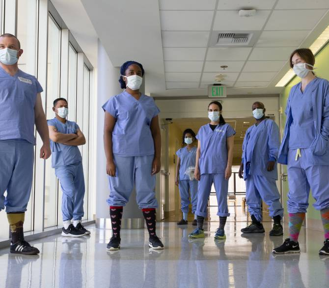 healthcare workders stand in formation