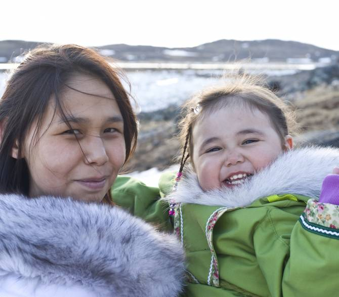 Inuit Mother and Daughter on Baffin Island, Nunavut, Canada; Getty