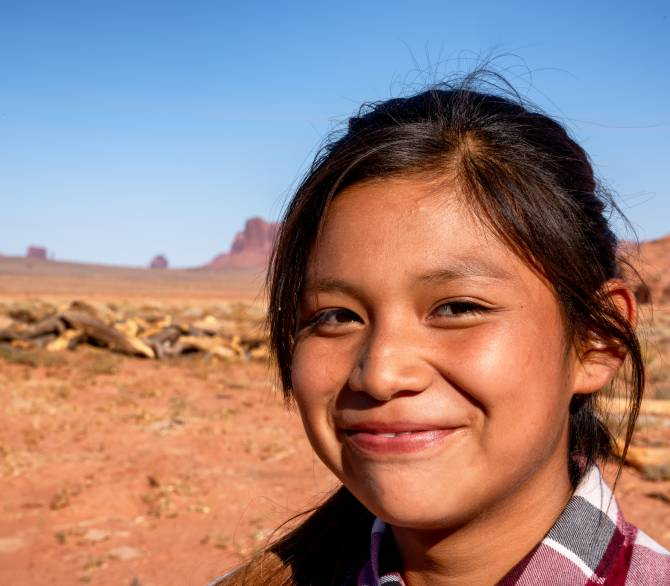Outdoor Portrait of a beautiful Navajo Native American Indian Girl in the Northern Arizona Desert on the Monument Valley Indian Reservation; Getty
